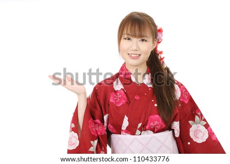 Young asian woman in clothes of kimono hand showing blank sign