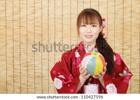 Young asian woman in clothes of kimono with paper balloon