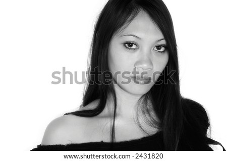 Young asian woman in front of white background looks sexy