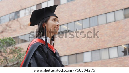 Young asian woman look at top in university campus