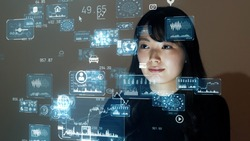 Young asian woman looking GUI (Graphical User Interface). System engineering.