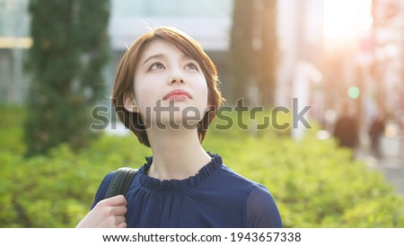 Young asian woman looking up to sky. Stock photo ©