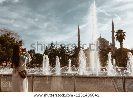 Young asian Woman photographing Blue mosque with fountain in the foreground - istanbul #1231436041