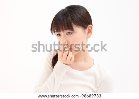 Young Asian woman pinch the nose white background