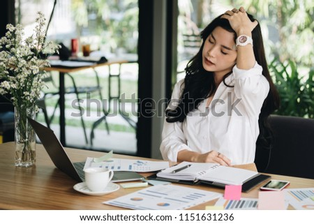 young asian woman put hand on head feeling tired, frustrated & stressed from hard work at office. exhausted businesswoman have headache at workplace.