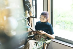 Young asian woman reading a book.