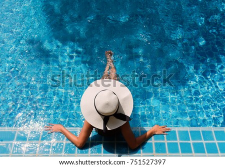 Young asian woman relaxing in swimming pool at spa resort.relaxing concept. #751527397