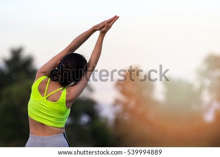 Young asian woman runner resting after workout session #539994889