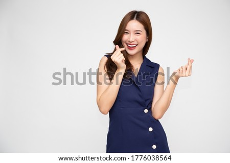 Young Asian woman showing mini heart sign isolated on white background, Speading love and happiness concept