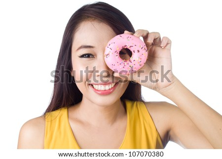 Young asian woman smiling with sweet colorful donut on white background