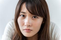 young asian woman staring at camera