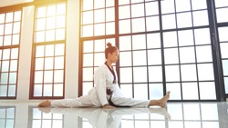 Young asian woman stretches her leg straight during warm up