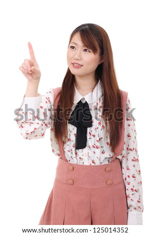 young asian woman touching with finger isolated on white background