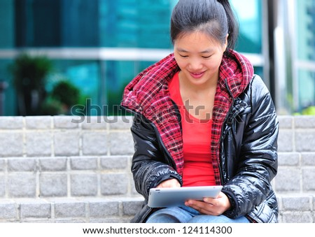 young asian woman use tablet pc