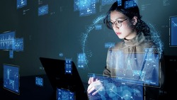 Young asian woman watching hologram screens. Business technology.