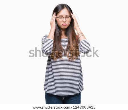 6823c9caf4d Young asian woman wearing glasses over isolated background with hand on head  for pain in head