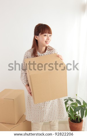 Young Asian woman with a cardboard box
