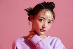 Young Asian woman with glitter make-up wearing sporty fashion