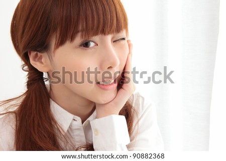Young Asian woman with toothache