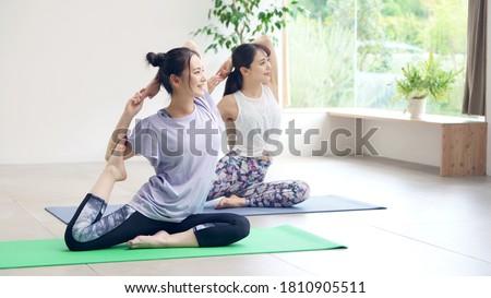 Young asian women doing yoga. Yoga instructor.