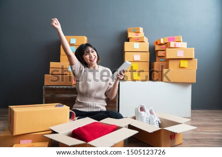Young asian women happy after new order from customer. Surprise and shock face of asian woman success on making big sale of his online store. Online Selling. Online Shopping