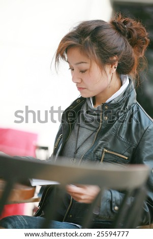 young asian women  reading book