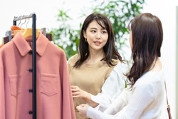 Young asian women watching clothes in apparel shop.