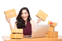 Young asian women with startup small business entrepreneur freelance working at home and excited about the orders of many customers, Online marketing packing box delivery concept, Thai model