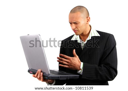 Young Asian Worker Stylish young man in suit working on his laptop. Isolated over white.