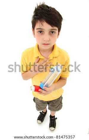 Young asthmatic child with inhaler and spacer chamber over white background. Periorbital hyperpigmentation.