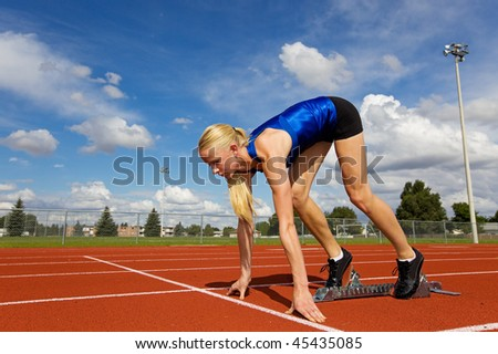 Young athlete on the starting blocks ready to race