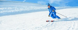 Young athlete skiing in alps mountains on sunny day - Skier riding down for winter snow sport competition - Training and vacation concept - Man focus on man head - Warm vivid filter