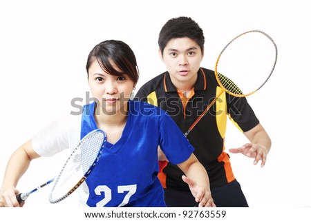 Young athletes in badminton doubles.Isolated in white background.