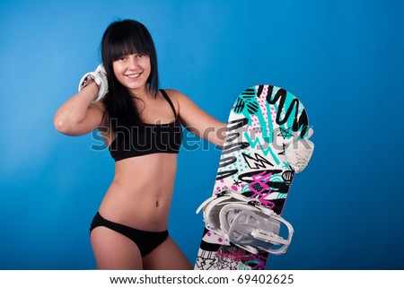 young athletic girl  with snowboard