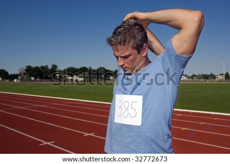 Young Athletic male warms up prior to racing or training