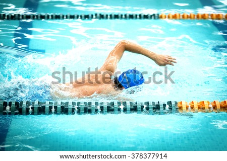 Young athletic man with butterfly swimming technique