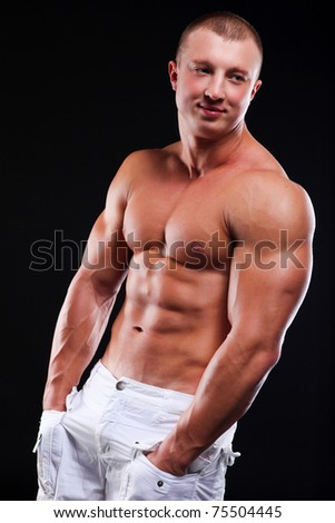 Young athletic man with perfect body of bodybuilder