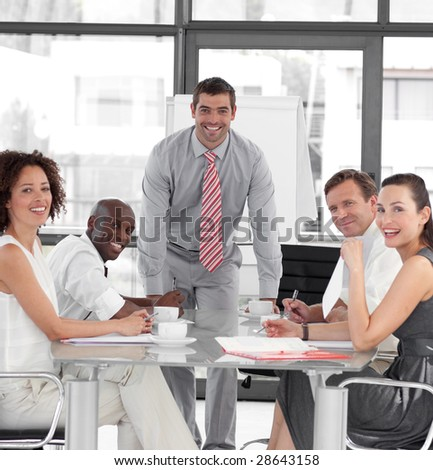 Young Attracitve Businessman giving a presentation