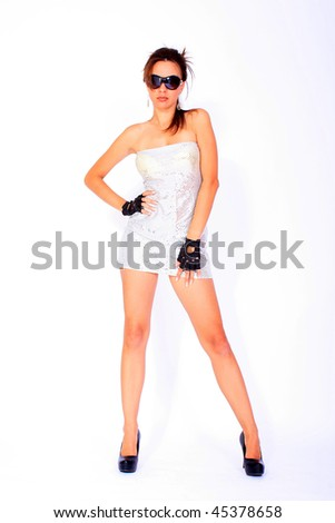 Young attractive action girl dressed i silver