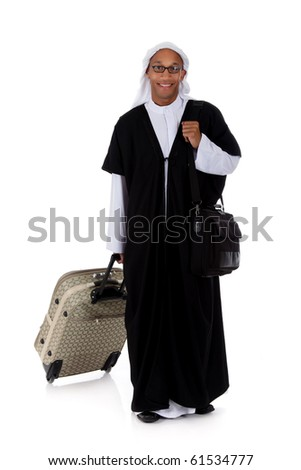 Young attractive African American man in sheikh posture dressed in arab garb, pulling his bag. Studio shot . White background