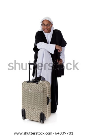 Young attractive African American man in sheikh posture dressed in arab garb, with the foot on the bag. Studio shot . White background