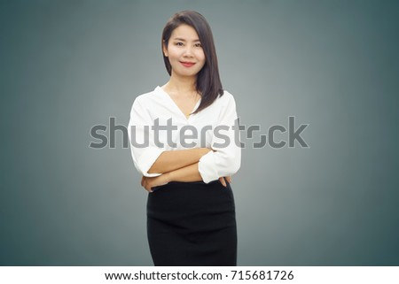Young attractive Asian business woman arm cross standing and smiling over grey wall background  #715681726