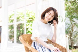 young attractive asian woman relaxing