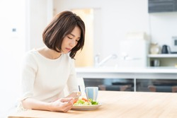 young attractive asian woman who eats,no appetite