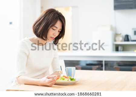 young attractive asian woman who eats,no appetite Stock photo ©