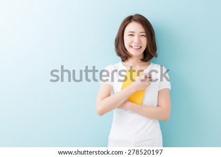 young attractive asian woman who reads a book #278520197