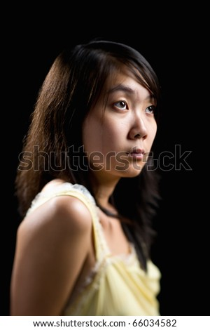young attractive asian woman with only her eyes in clear focus