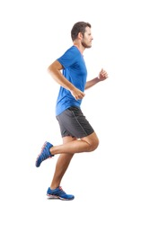 Young attractive athlete running and showing perfect running technique. View from the profile side. Isolated cut out on white background.