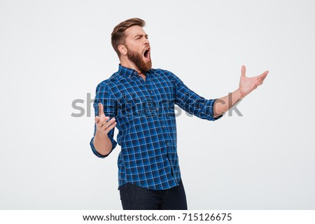 Young attractive bearded man singing loud while standing isolated over white background #715126675