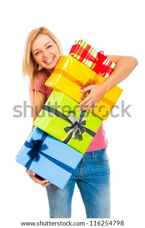 Young attractive blond laughing woman holding stack of colorful gift boxes, isolated on white background.